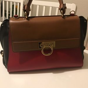 Salvatore Ferragamo top handle bag.